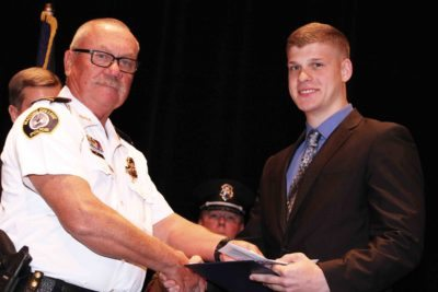 Photo courtesy of Macomb Police Academy POLC Executive Committee member and Macomb Community College Police Captain Tom Wilk (left) presents a LEEP Award to Joshua Baker during his graduation from Macomb Police Academy.